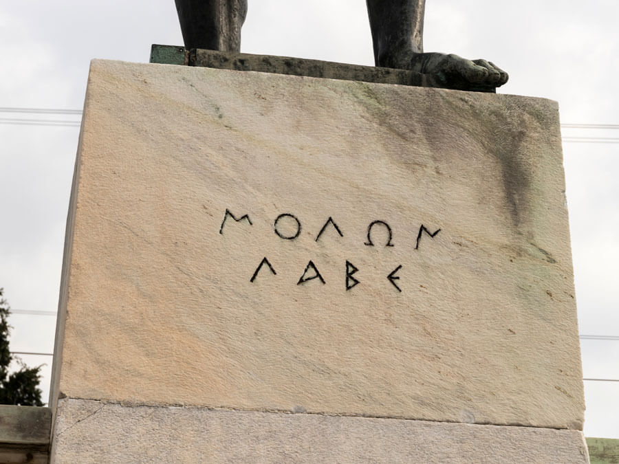 "Molon labe, meaning ""come and take [them]"", the famous reply of Leonidas to Xerxes"